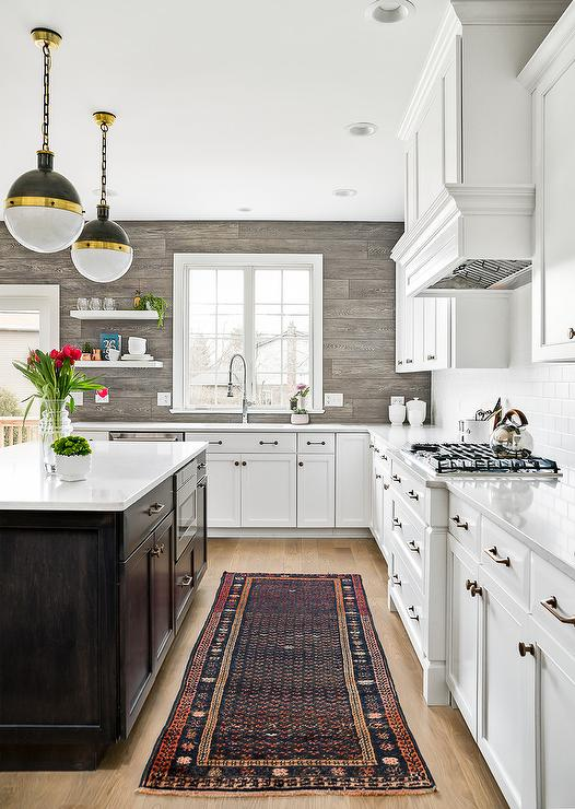 brown kitchen cabinets with blue walls