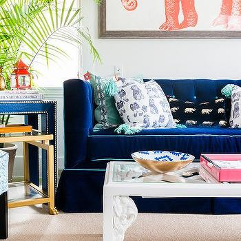 Jewel Blue Velvet Sofa With Teal Tassel Pillows