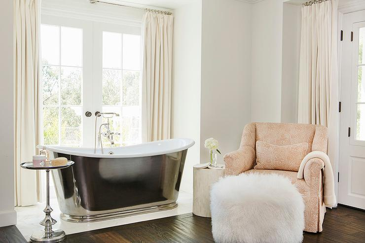 Cast Iron Bathtub With Pink Accent Chair