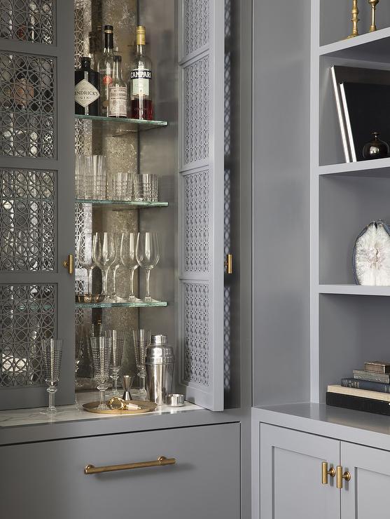 Gray Ornate Lattice Doors On Bar Cabinet Transitional Living Room