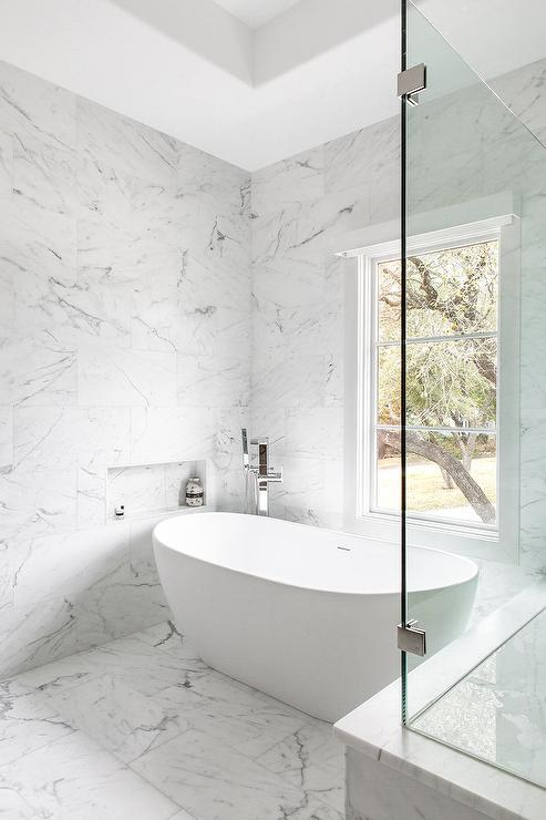 Modern Oval Tub With Wall Mount Tub Filler Transitional