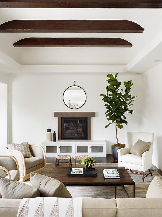 Brown Wood Fireplace Mantel Over White Cabinets Transitional