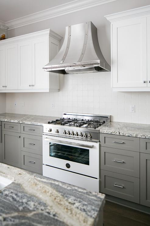 Superior Steel French Range Hood With White And Gray Cabinets