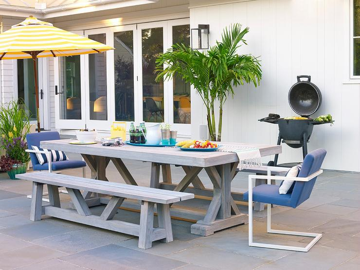 Stupendous Gray Wash Teak Outdoor Dining Table With Blue Chairs Ibusinesslaw Wood Chair Design Ideas Ibusinesslaworg