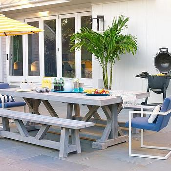 Gray Wash Teak Outdoor Dining Table With Blue Chairs