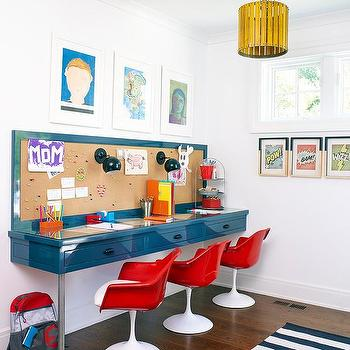 Red Tulip Chairs At Glossy Blue Desk With Plumbing Pipe Legs
