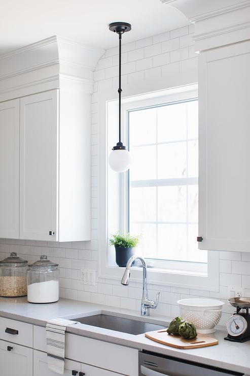 Small White Glass and Bronze Vintage Light Over Kitchen Sink ...