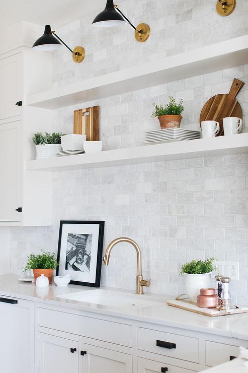 Aerin Charlton Sconces Over White Floating Kitchen Shelves