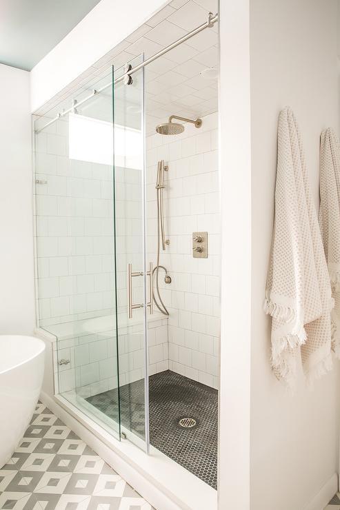 Black Hex Tile Shower Floor With White Shower Bench