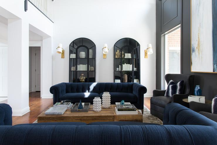 Jewel Blue Velvet Chesterfield Sofas With Black Wingback Chairs Transitional Living Room