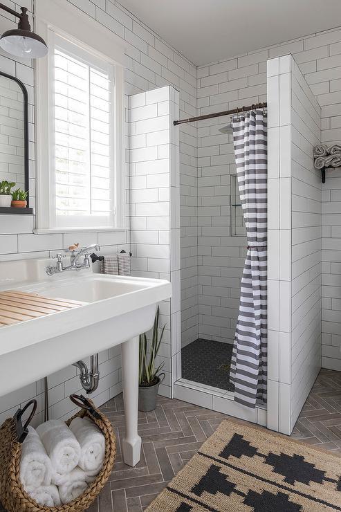 White Kohler Utility Sink With Brown Herringbone Tiles