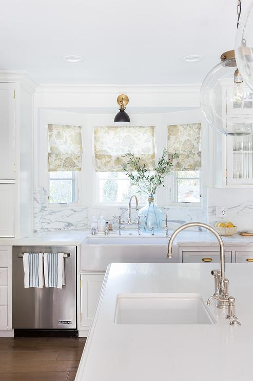 Clear Glass Globe Pendants Hang Over A Kitchen Island Boasting A White  Quartz Countertop Fitted With A Prep Sink And A Polished Nickel Gooseneck  Faucet.