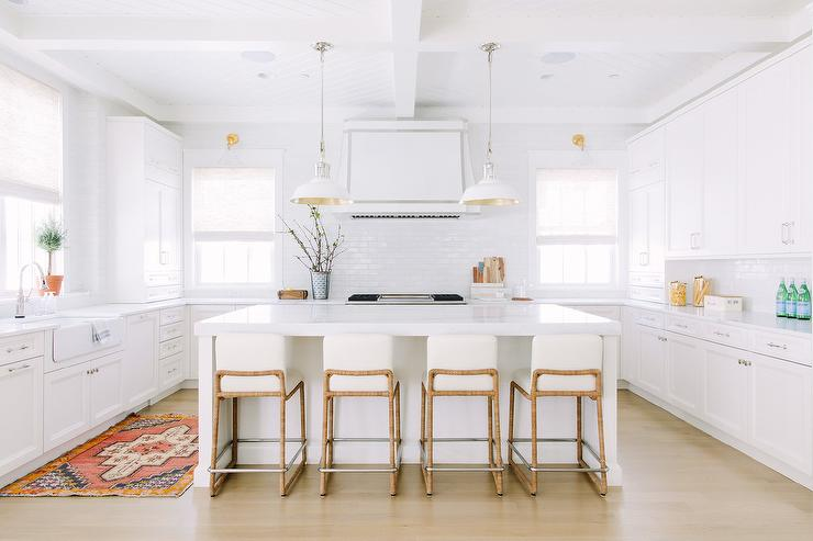 All White Kitchen With Gold And Red Vintage Rug Transitional