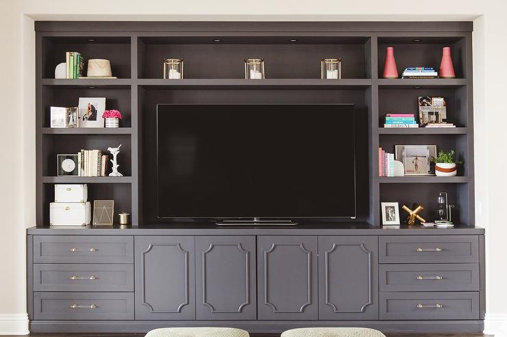 Charmant Glass And Brass Pulls And Ornate Trim Moldings Accent Dark Gray TV Cabinets  Positioned Beneath Lighted Dark Gray Shelves Fixed Framing A Flat Panel ...