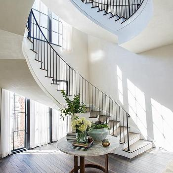 Winding Staircase With Round Marble Top Foyer Table