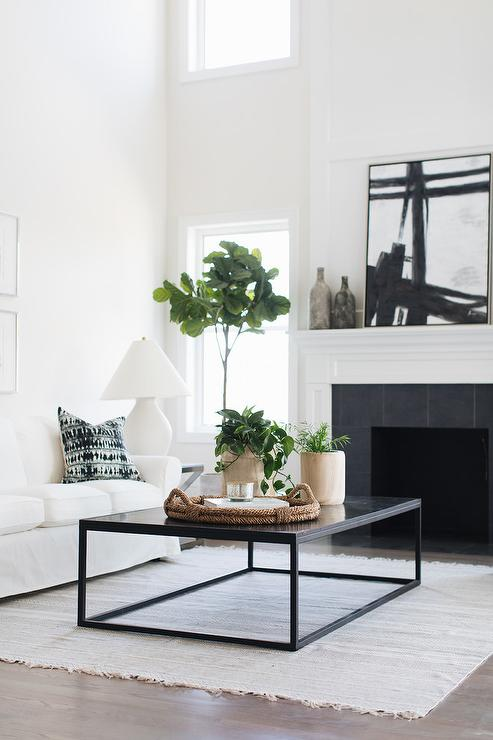 Blue Tufted Accent Chairs With White Brick Fireplace