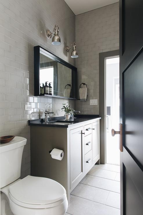Bathroom With Gray Subway Tiles And Black Floor Tiles