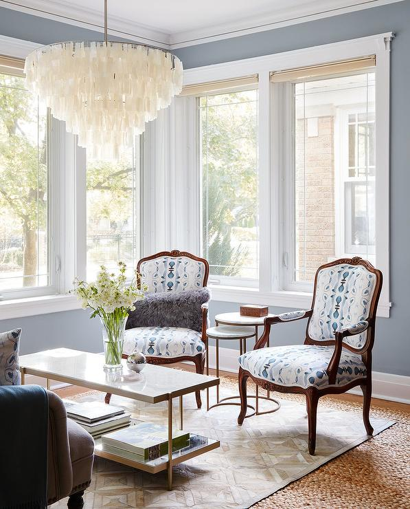Blue Living Room With White Capiz Chandelier