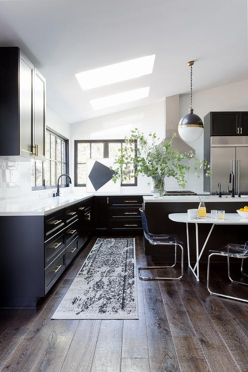 Glossy Black Kitchen Cabinets with Long Brass Pulls ...