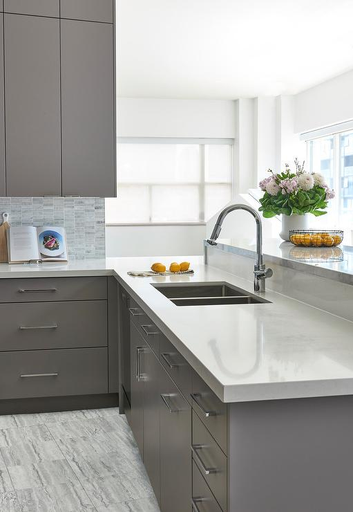 Gray Flat Front Kitchen Cabinets With White Quartz Countertop Transitional Kitchen