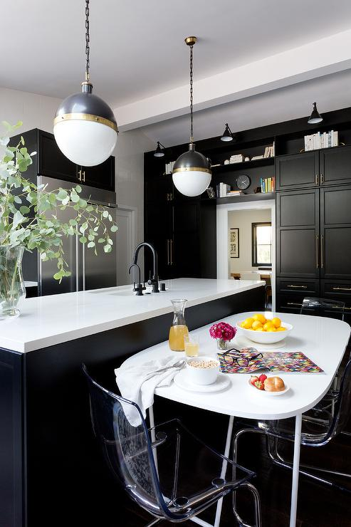 White Oval Dining Table In Front Of Black Kitchen Island Transitional Kitchen