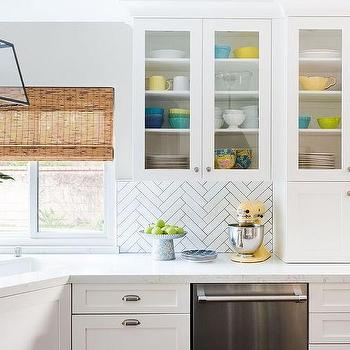 Colorful Pottery In Glass Front Kitchen Cabinets