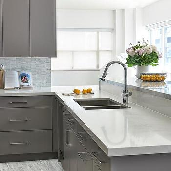 Gray Flat Front Kitchen Cabinets With White Quartz Countertop