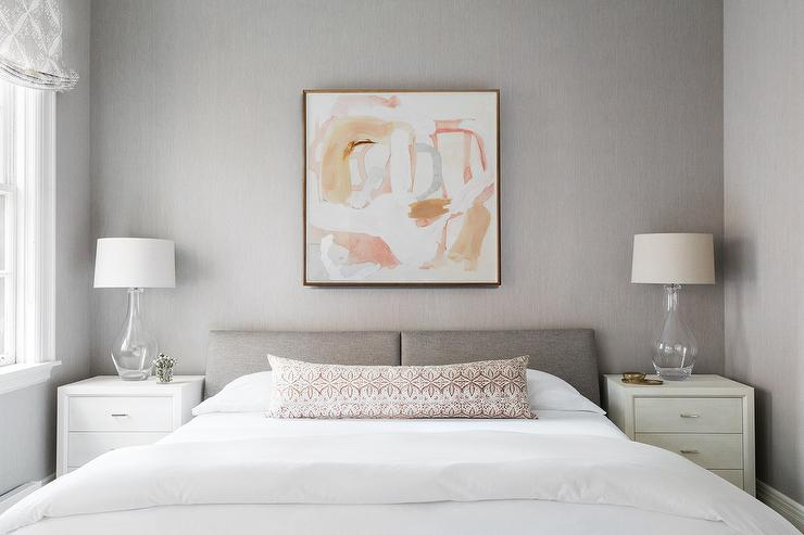 A Low Gray Headboard Sets Off A Neutral Base To This Bedroom Adding Minimal  Patterns To Create Visual Interest.