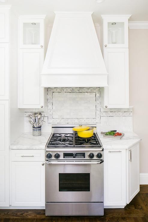 white french wood range hood wth mosaic marble tiles marble glass splashback glass marble stove backsplash