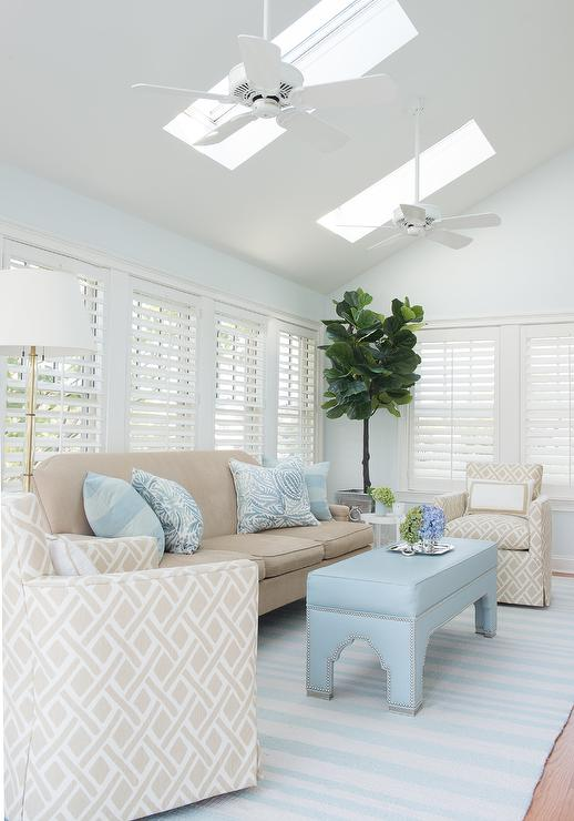 Blue And Beige Living Room With Skylights