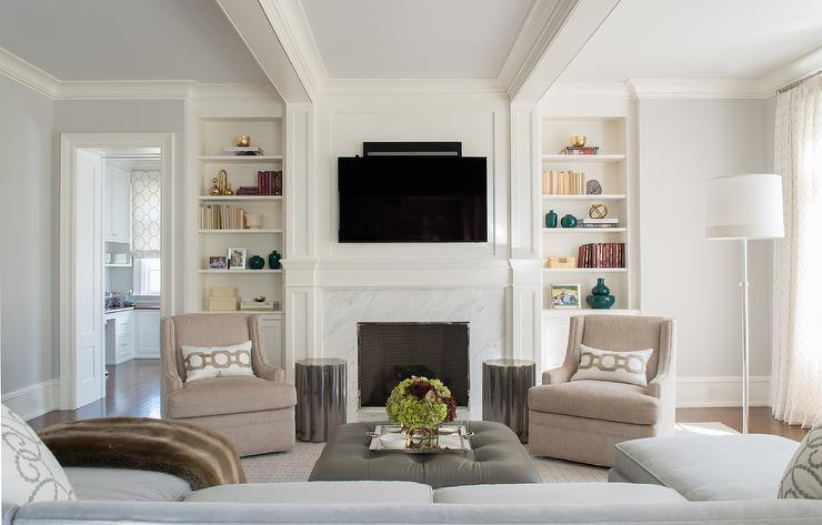 Beige Swivel Chairs With Gray Scalloped Accent Tables