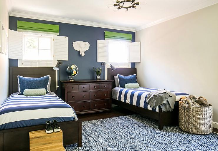 Blue And Gray Boy Bedroom With Bed Under Window