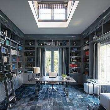 Blue Paneled Den With Dark Blue Built In Bookcases