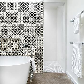 Oval Bathtub In Front Of Marble Mosaic Wall Transitional