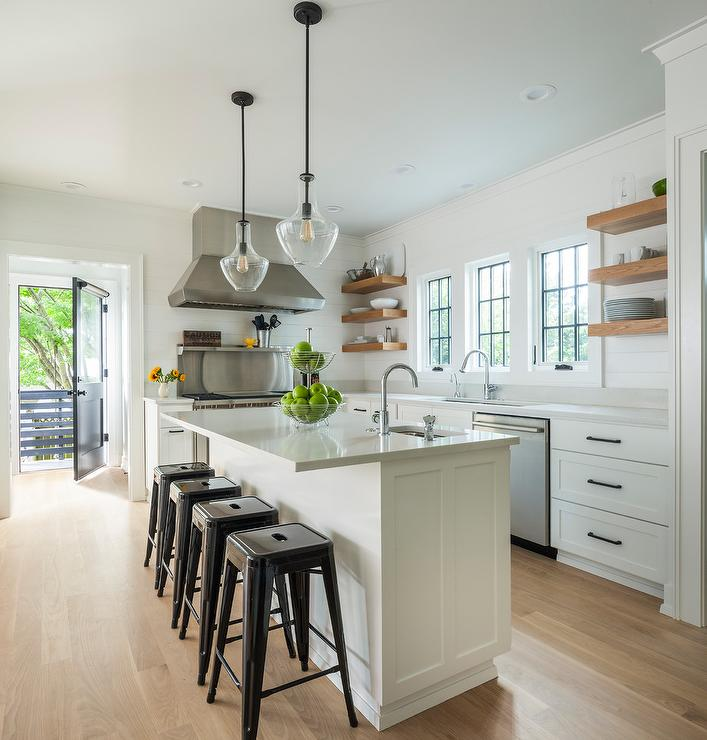 White Kitchen Cabinets With Caramel Stained Wood Floating Shelves