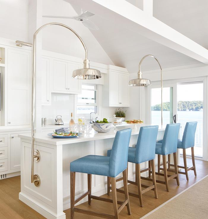 Blue Leather Stools At White Kitchen Island With Industrial Lighting Transitional Kitchen