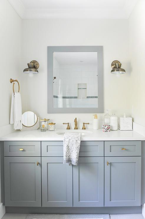 White Dual Bath Vanity With Shiny Gold Hardware And Mirror