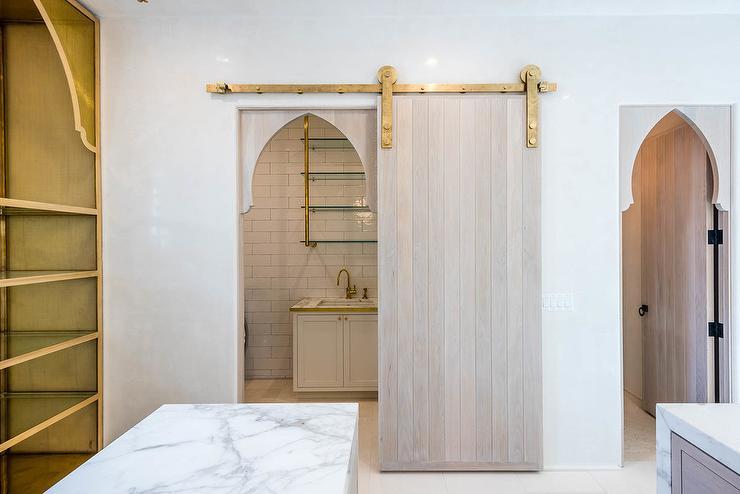 Gray Wood Plank Pantry Door on Brass Rails & Gray Wood Plank Pantry Door on Brass Rails - Mediterranean - Kitchen