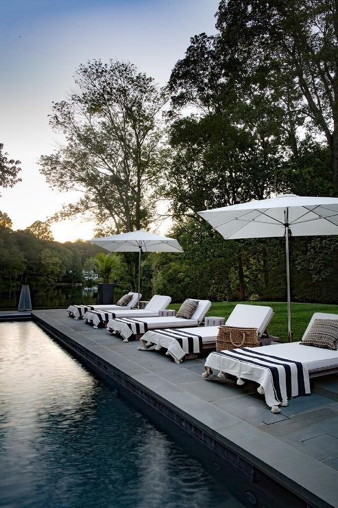 Teak Pool Lounger with Black and White Stripe Tassel Towels ...