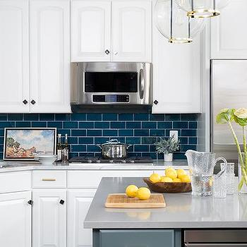 Dark Blue Subway Tiles With White Cabinets