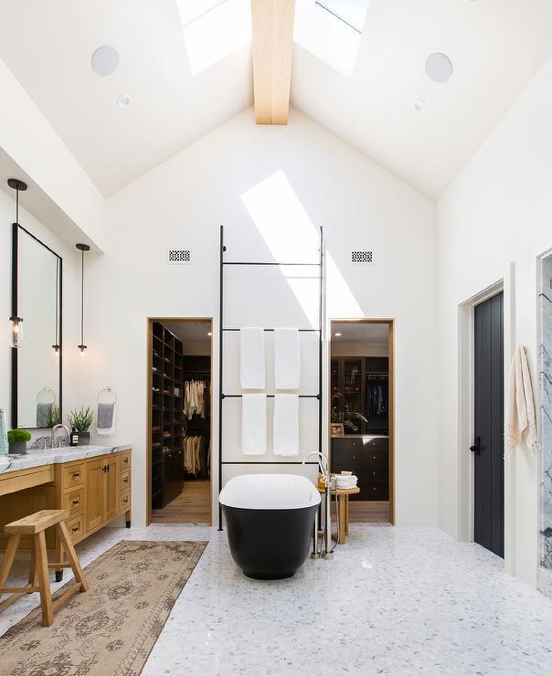 Black Cast Iron Bathtub With Tall Black Towel Ladder