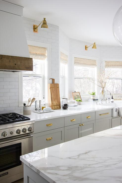 White Kitchen With Gold Gooseneck Faucet Contemporary