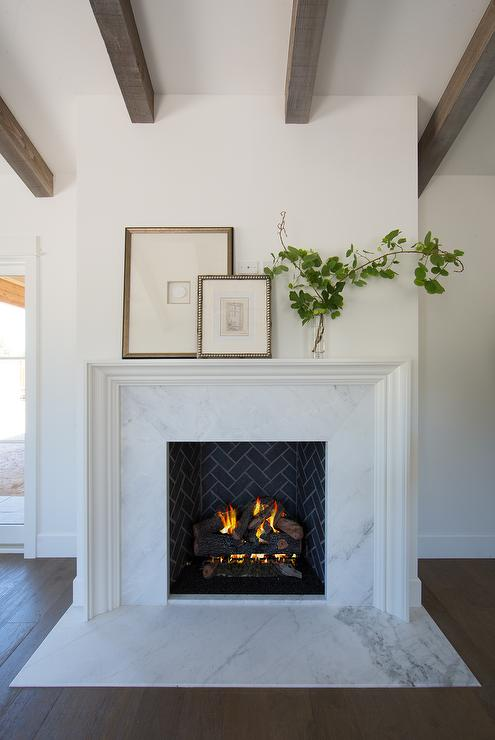 Beveled Fireplace Mantel With White Marble Tiles