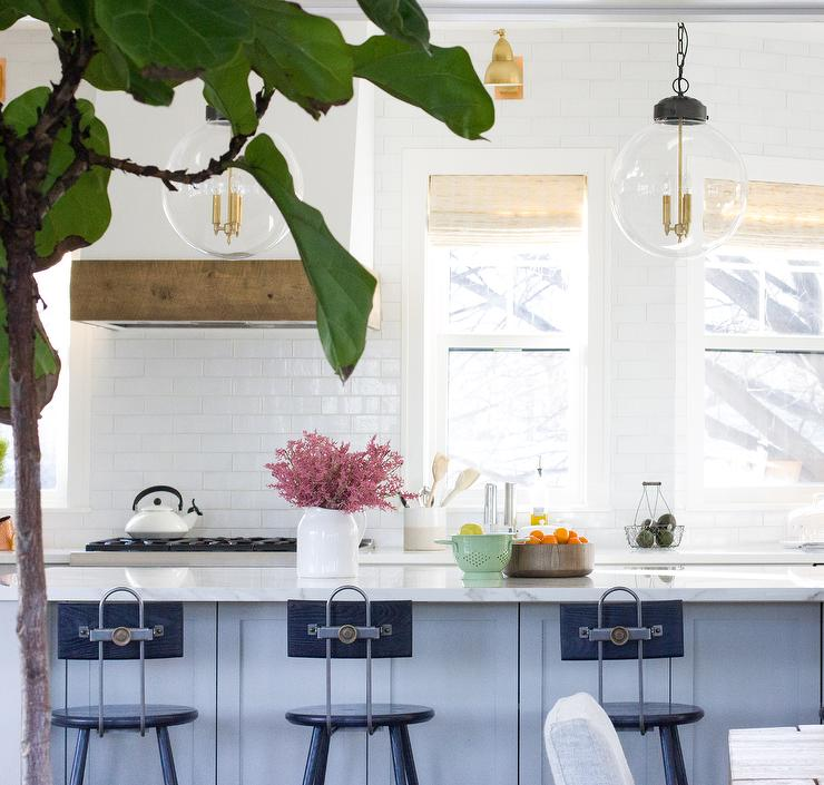 Welcoming White Kitchen Is Illuminated By Regina Andrew: Butcher Block Top Island With Hans Wegner Elbow Bar Stools