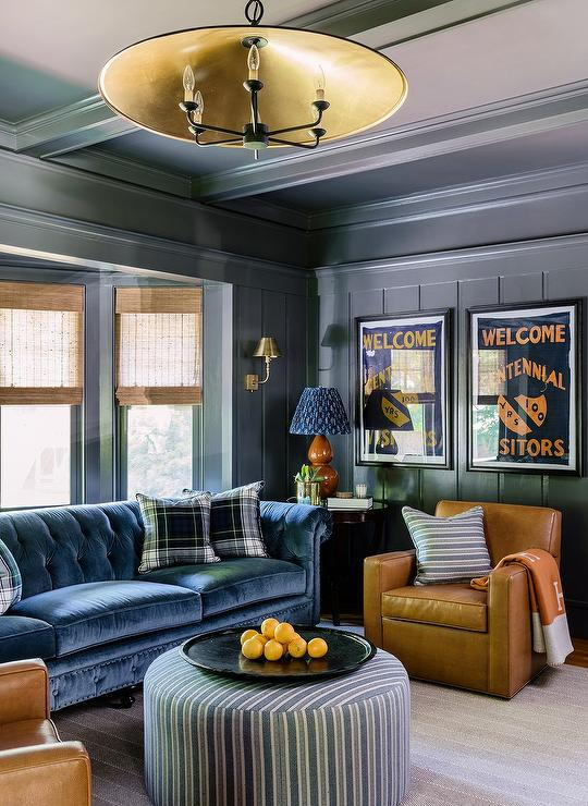 Wood Paneled Den: Blue Paneled Den With Brown Leather Chesterfield Sofa