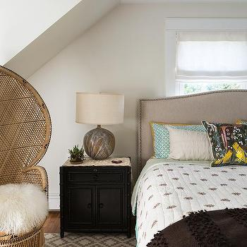 Beige Camelback Bed with Black Bamboo Nightstand Cabinet