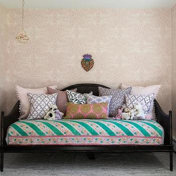 Black Cane Daybed with Colorful Pillows