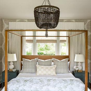 Brown Wood Canopy Bed with Black Nightstands