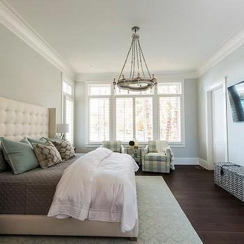 Cream Wingback Bed with Green and Gray Bedding