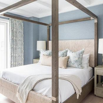 Brown Oak Canopy Bed on Blue Wall